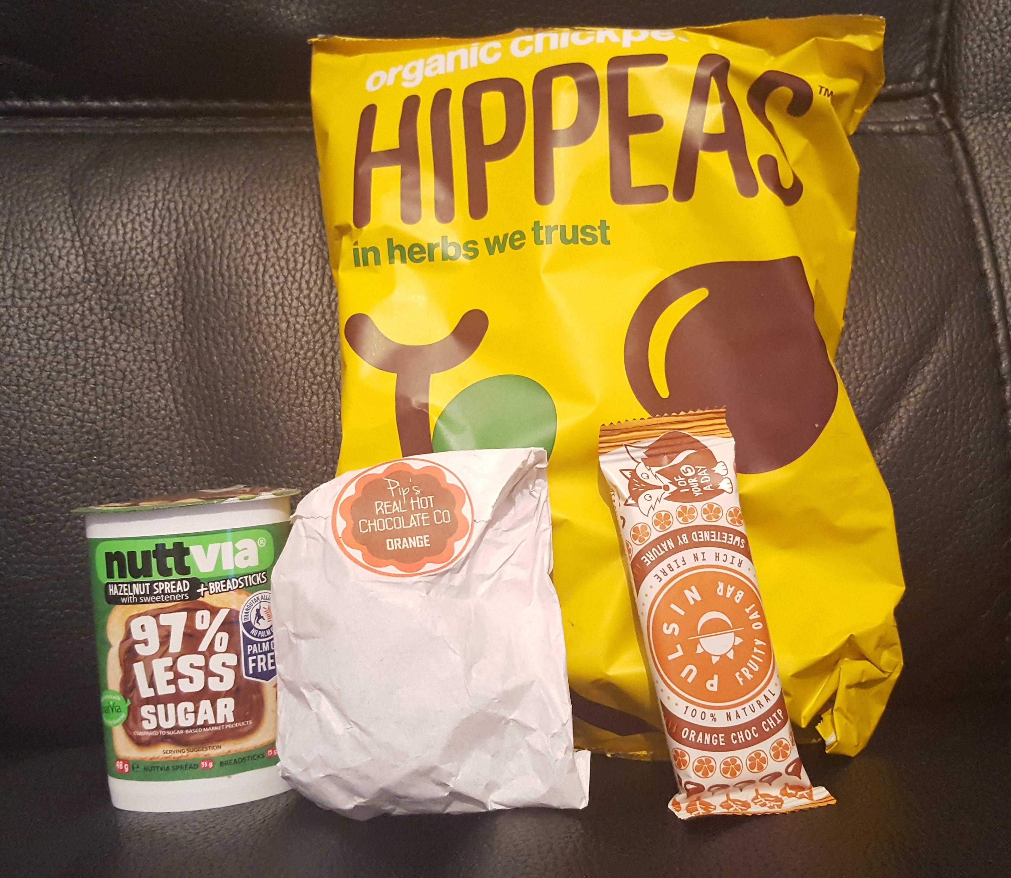 Degustabox - Nuttvia Breadsticks Snackpack - Pip's Real Hot Chocolate Co Real Hot Chocolate Coins - Pulsin Kids' Fruity Oat Bars Orange Choc Chip - Hippeas Organic Chickpea Puffs