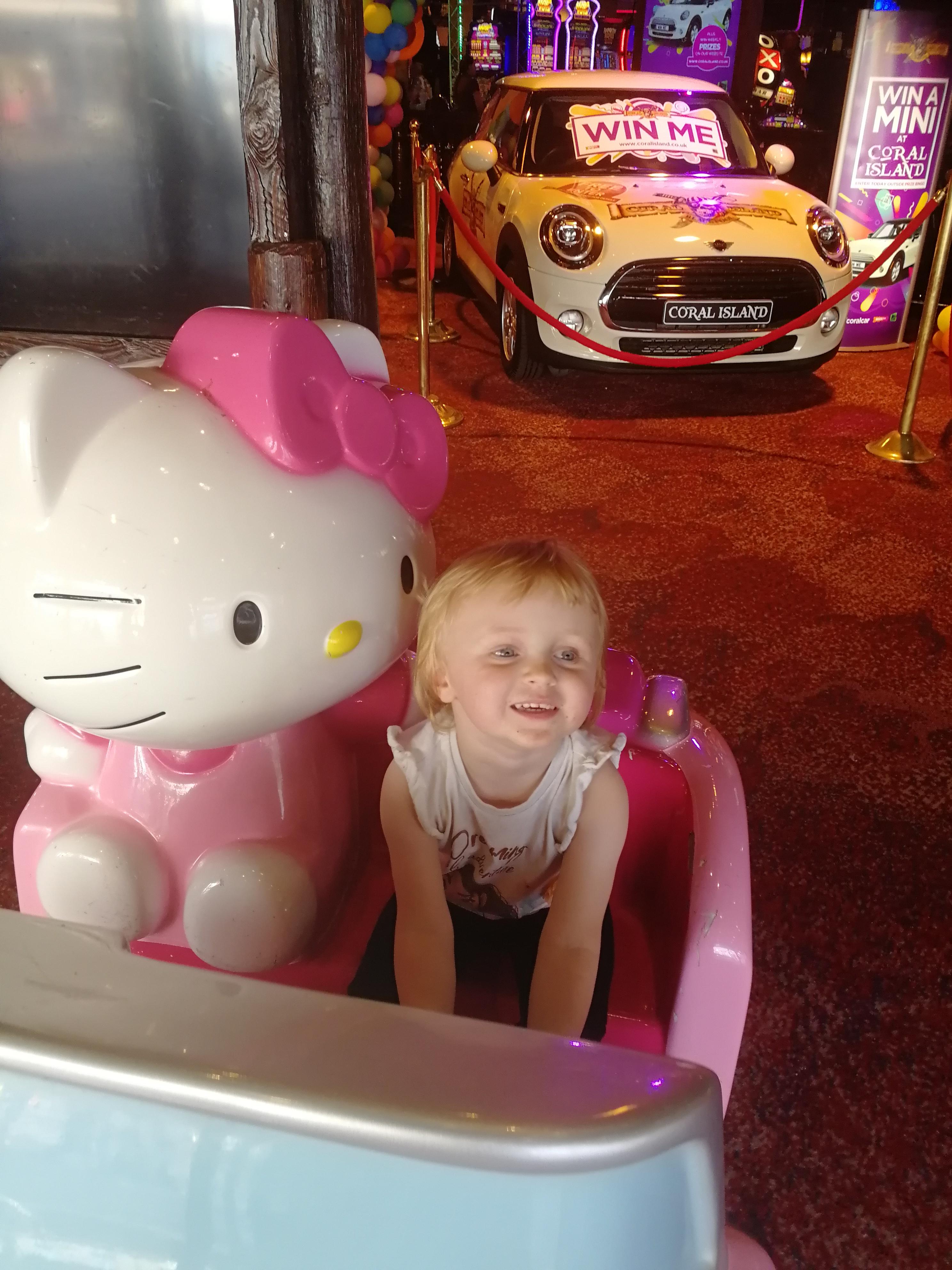 Olivia on the Hello Kitty ride
